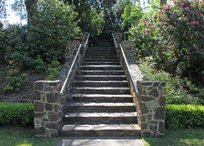 Brick steps. Steps created using large stones leading through garden Royalty Free Stock Photography