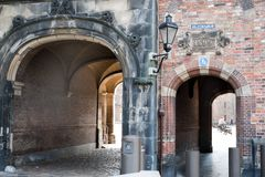 A series of archways connects the parliamentary buildings in The Hague Netherlands. Brick and stone archways connect the Binnenhof legislative district of the stock photography