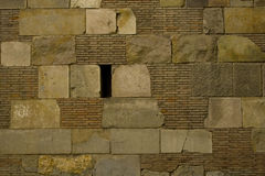 Brick and stone block wall texture. Detail of ancient roman brick and stone block wall Stock Image