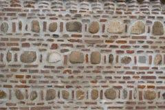 Brick and stone masonry wall background Royalty Free Stock Photo