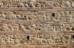 Brick and stone medieval wall textured background stock image