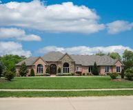Brick and Stone Suburban Home Stock Image