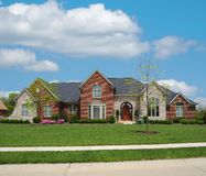 Brick and Stone Suburban Home Stock Photo