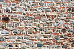 Brick and stone wall. Outer defensive wall of a fortress made from stone and brick Stock Image