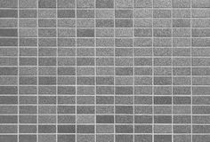 Brick stone wall. Black brick stone wall seamless background and texture Stock Images