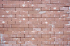 Brick stone wall texture. A photo of brick stone wall with color stain texture background, close up Stock Photos
