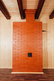 Brick stove in wooden house Stock Photos