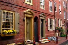 Brick street front. Old houses in red brick Royalty Free Stock Photos