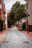 Brick street in Philadelphia PA. On a rainy summer day Stock Photos