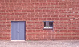 Brick Structure with Gray Doors Royalty Free Stock Images
