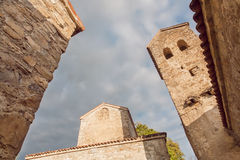 Brick structures of historical city with towers on cloudy sky Stock Photo