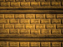 Facade with extruded bricks and moldings. Exterior texture. royalty free stock photos