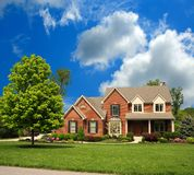 Brick Suburban 2-Story Home Stock Images
