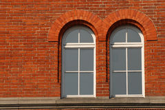 Brick surrounded windows Stock Photography