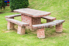 Brick table and chairs Royalty Free Stock Photography