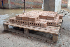 Brick on table of under constructed building site Stock Image