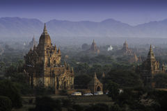 Brick temples in Bagan, Myanmar. People climb to top of the pagoda to see the sunset Stock Photography