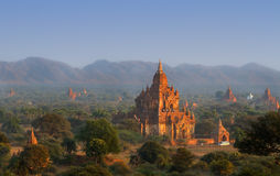 Brick temples in Bagan, Myanmar. People climb to top of the pagoda to see the sunset Stock Images