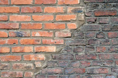 Brick texture. Brick wall texture made of different types of bricks new and old and a diagonal concrete separation line royalty free stock photo