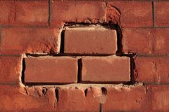 Brick texture. Texture of an old brick wall with 3 new bricks royalty free stock image