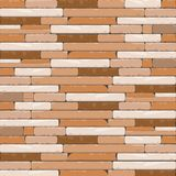 Brick Textures Background in Shades of Brown and Creamy White. This domestic uniform Brick wall background is a beautiful blend of chocolate and Saddle brown Royalty Free Stock Images