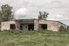 Brick thrown building. The destroyed building in the wood. The thrown disbanded military unit. Russia Stock Photography