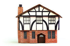 Timber frame house paper model - Frontview. A model of a Timber frame or Brick and timber house made with corrugated card and paper Royalty Free Stock Photography