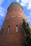 Brick tower. Old brick tower raising up towards the sky royalty free stock photography