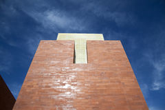 Brick Tower and Glass. A brick tower with yellow glass and blue sky Royalty Free Stock Photos