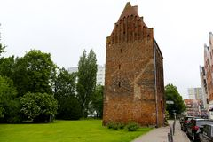 The brick tower in Kolobrzeg in Poland. Kolobrzeg, Poland - June 17, 2017: The old brick tower, which is part of the medieval defensive system, is now an stock photography