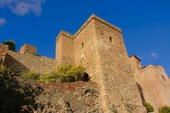 Brick tower, part of the fortifications of the Alcazaba moorish castle, Malaga. Brick fortified tower of the Alcazaba moorish castle, Malaga,  on a sunny day Royalty Free Stock Photo