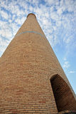 Brick tower scraping sky Stock Photos