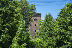 Brick tower between trees Stock Photography