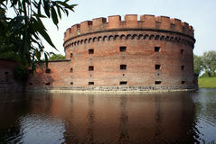 Brick tower and water Stock Photography