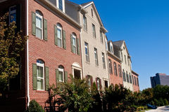 Brick Townhouses Under Blue Skies Stock Photo