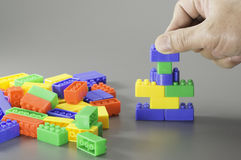 Brick toy and hand Royalty Free Stock Photography