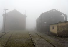 Brick Train Workshop and a Ruined House in the Fog. A brick train workshop in the fog. On its side a ruined steam engine house. Paranapiacaba, Sao Paulo state royalty free stock images