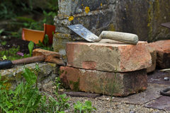 Brick & Trowel. In the foreground bricks and trowel royalty free stock photo