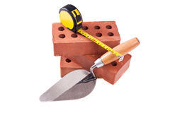 Brick , trowel And meter Royalty Free Stock Photos
