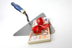Brick trowel with money gift Royalty Free Stock Image