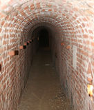 Brick tunnel of a secret underground passage Stock Images