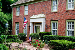 Brick Two Story with Two American Flags Stock Photography