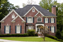 Brick Two Story With Japanese Maple