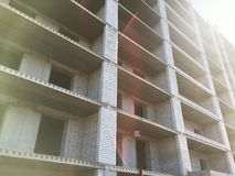 Brick unfinished construction of an apartment house Stock Images