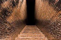 Brick vault entrance. Ancient Ruins / Vault entrance with old brick wall and stairs Stock Photo