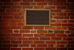Brick with ventilation grill Stock Photos