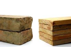 Brick versus wood Stock Photography