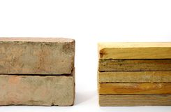 Brick versus wood. Comparison between these two type of building materials Royalty Free Stock Image