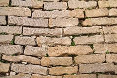 Brick vintage wall plastered with a stone close up / Part of architectural background, rustic materials and texture detail Royalty Free Stock Photos