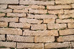 Brick vintage wall plastered with a stone close up / Part of architectural background, rustic materials and texture detail Stock Photo
